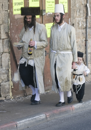 JERUSALEM - MARS 09 : Ultra Orthodox family during Purim in Mea Shearim Jerusalem on Mars 09 2012 , Purim is a Jewish holiday celebrates the salvation of the jews from jenocide in ancient Persia