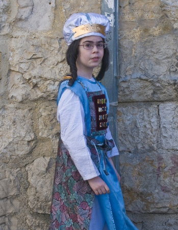 hasidic: JERUSALEM - MARS 09 : Ultra Orthodox costumed girl during Purim in Mea Shearim Jerusalem on Mars 09 2012 , Purim is a Jewish holiday celebrates the salvation of the jews from jenocide in ancient Persia