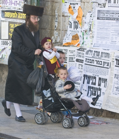 haredi: JERUSALEM - MARS 09 : Ultra Orthodox family during Purim in Mea Shearim Jerusalem on Mars 09 2012 , Purim is a Jewish holiday celebrates the salvation of the jews from jenocide in ancient Persia  Editorial