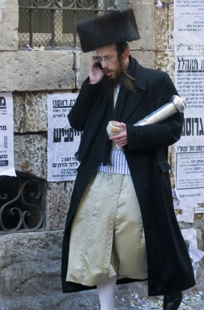 hasidim: JERUSALEM - MARS 09 : Ultra Orthodox man during Purim in Mea Shearim Jerusalem on Mars 09 2012 , Purim is a Jewish holiday celebrates the salvation of the jews from jenocide in ancient Persia