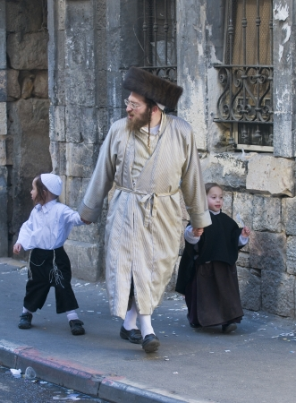 JERUSALEM - MARS 09 : Ultra Orthodox family during Purim in Mea Shearim Jerusalem on Mars 09 2012 , Purim is a Jewish holiday celebrates the salvation of the jews from jenocide in ancient Persia  Stock Photo - 14816894