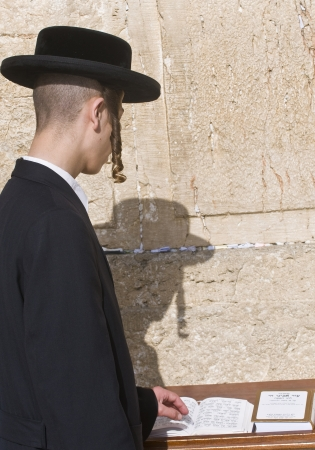 JERUSALEM - APRIL 08 : Orthodox jewish men prays in The western wall during Passover on April 08 2012 , The Western wall is important Jewish religious site located in the Old City of Jerusalem