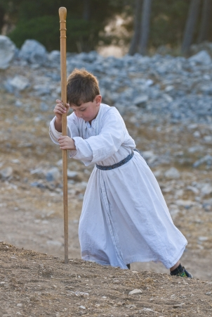 shavuot: NABLUS, WEST BANK - JUNE 24 : Young Member of the ancient Samaritan community during the holy day of Shavuot in Mount Gerizim on June 24 2012, Shavuot is an holyday commemoretas the anniversary of the day god have given the Torah to the Israelites Editorial