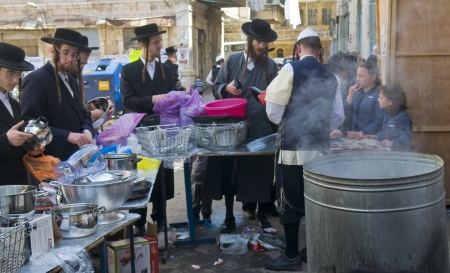 haredi: JERUSALEM - APRIL 05 : An Ultra Orthodox men is preparing to the Jewish holiday of Passover by purifacation of the dishes in Jerusalem Israel on April 05 2012
