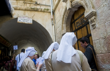 dolorosa: JERUSALEM - APRIL 13 : Unidentified nuns prays in the sixth station of the Via Dolorosa during Good Friday in Jerusalem Israel on April 13 2012