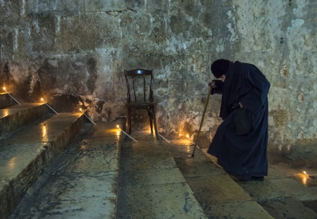 JERUSALEM - AUGUST 25 : Unidentified old nun in the Tomb of Mary in Gethsemane during the feast of the Assumption of the Virgin Mary on August 25 2012 in old Jerusalem Israel