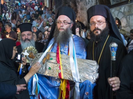 JERUSALEM - AUGUST 25 : Unidentified bishops brought the icon of the Virgin Mary to the Tomb of Mary in Gethsemane during the feast of the Assumption of the Virgin Mary on August 25 2012 in old Jerusalem Israel