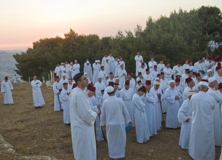samaritans: NABLUS, WEST BANK - JUNE 24 : Members of the ancient Samaritan community prays during the holy day of Shavuot in Mount Gerizim on June 24 2012, Shavuot is an holyday commemoretas the anniversary of the day god have given the Torah to the Israelites