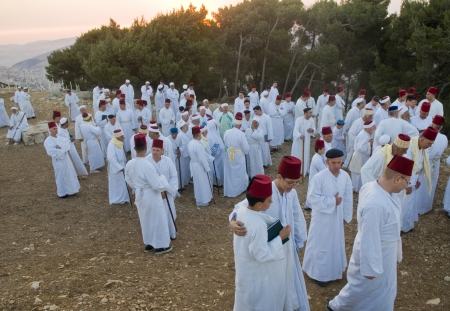 NABLUS, WEST BANK - JUNE 24 : Members of the ancient Samaritan community prays during the holy day of Shavuot in Mount Gerizim on June 24 2012, Shavuot is an holyday commemoretas the anniversary of the day god have given the Torah to the Israelites