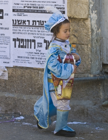 shearim: JERUSALEM - MARS 09 : Ultra Orthodox costumed boy during Purim in Mea Shearim Jerusalem on Mars 09 2012 , Purim is a Jewish holiday celebrates the salvation of the jews from jenocide in ancient Persia