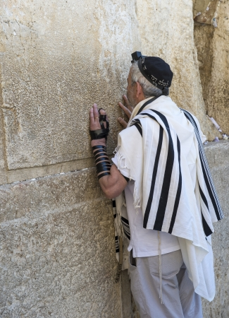 exprassion: JERUSALEM - JULY 29 : Jewish man prays in the Wailing wall during the Jewish holyday of Tisha Bav , on July 29 2012 in old Jerusalem , Israel