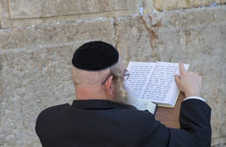 tefillin: JERUSALEM - JULY 29 : Jewish man prays in the Wailing wall during the Jewish holyday of Tisha Bav , on July 29 2012 in old Jerusalem , Israel