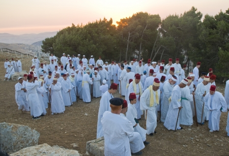 nablus: NABLUS, WEST BANK - JUNE 24 : Members of the ancient Samaritan community prays during the holy day of Shavuot in Mount Gerizim on June 24 2012, Shavuot is an holyday commemoretas the anniversary of the day god have given the Torah to the Israelites