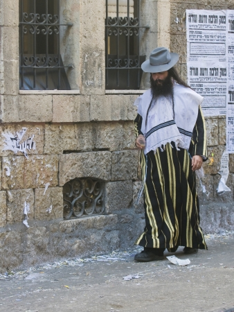 shearim: JERUSALEM - MARS 09 : Ultra Orthodox man during Purim in Mea Shearim Jerusalem on Mars 09 2012 , Purim is a Jewish holiday celebrates the salvation of the jews from jenocide in ancient Persia