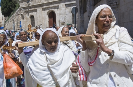 dolorosa: JERUSALEM - APRIL 13 : Ethiopian Christian pilgrims carry across along the Via Dolorosa in Jerusalem on April 13 2012 commemorating the path Jesus carried his cross on the day of his crucifixion