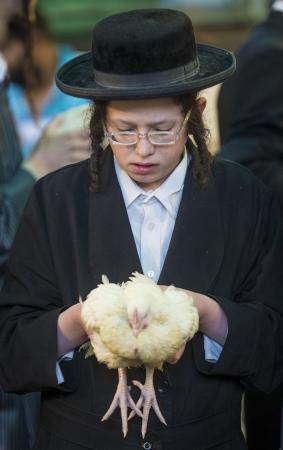 JERUSALEM - SEP 25 : An ultra Orthodox Jewish holds chicken during the Kaparot ceremony held in Jerusalem Israel in September 25 2012
