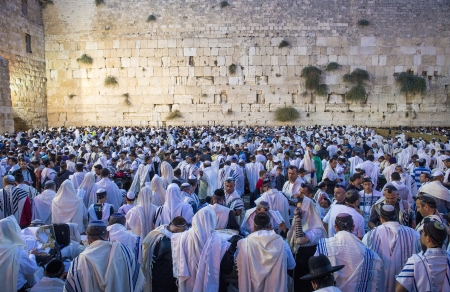 JERUSALEM - SEP 25 : Jewish men prays during the penitential prayers the Selichot , held on September 25 2012 in the Wailing wall in Jerusalem Israel  Editorial
