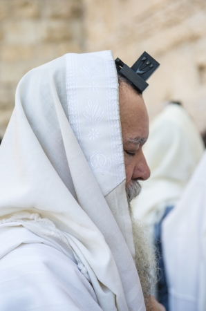 selichot: JERUSALEM - SEP 25 : Jewish man prays during the penitential prayers the Selichot , held on September 25 2012 in the Wailing wall in Jerusalem Israel