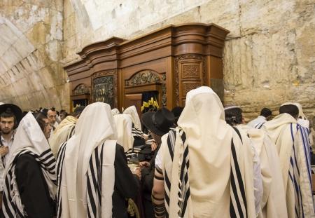JERUSALEM - JULY 29 : Jewish men prays in the Wailing wall during the Jewish holyday of Tisha Bav , on July 29 2012 in old Jerusalem , Israel  Editorial