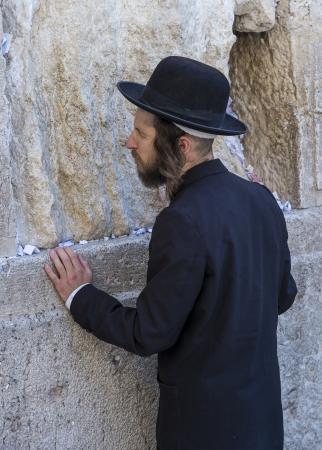 JERUSALEM - JULY 29 : Jewish man prays in the Wailing wall during the Jewish holyday of Tisha Bav , on July 29 2012 in old Jerusalem , Israel