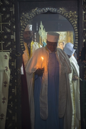 JERUSALEM - AUGUST 08 : Ethiopian priests prays at the Ethiopian Church in Jerusalem , Israel on August 08 2012 , Ethiopian church is The only pre-colonial Christian church of Sub-Saharan Africa