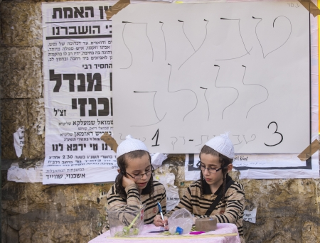 JERUSALEM - SEP 28 : An ultra-orthodox Jewish children sells Lulav's ring in the Four spesies market in Jerusalem Israel on September 28 2012 , Lulav is one of the Four spesies used during the celebration of Sukot