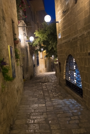 A narrow street at night in historic Jaffa , Israel