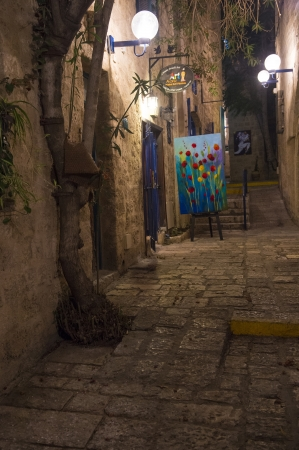 JAFFA , ISRAEL - AUGUST 15 2012 :  A narrow street at night in historic Jaffa , Israel