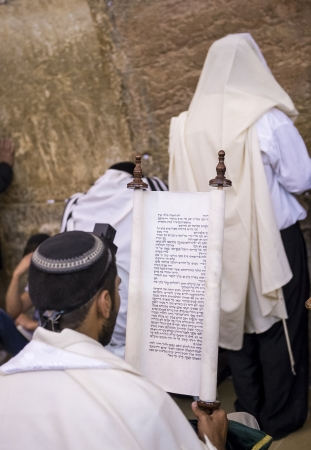 exprassion: JERUSALEM - JULY 29 : Jewish men prays in the Wailing wall during the Jewish holyday of Tisha Bav , on July 29 2012 in old Jerusalem , Israel  Editorial