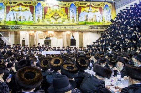 BNEI BRAK , ISRAEL - OCT 01 : Orthodox Jews from the Hasidic dynasty Vizhnitz celebrates Simchat beit Hashoeivah in Bnei Brak Israeel on October 01 2012 , It's a special celebration held by Jews during Sukkot Editorial