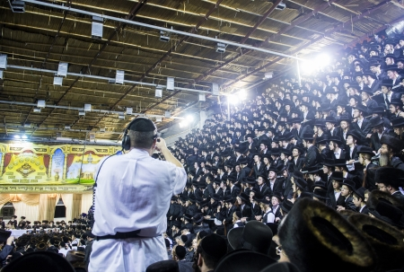 raligion: BNEI BRAK , ISRAEL - OCT 01 : Orthodox Jews from the Hasidic dynasty Vizhnitz celebrates Simchat beit Hashoeivah in Bnei Brak Israeel on October 01 2012 , Its a special celebration held by Jews during Sukkot