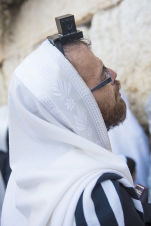 JERUSALEM - SEP 25 : Jewish man prays during the penitential prayers the Selichot , held on September 25 2012 in the Wailing wall in Jerusalem Israel  Stock Photo - 16497023