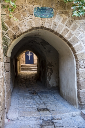 A narrow street and a church in historic Jaffa , Israel