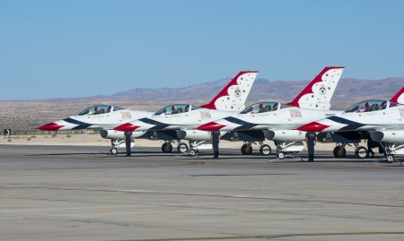 thunderbird: LAS VEGAS - NOVEMBER 11: Thunderbird F-16 Aircrafts preparing to an air show on November 11, 2012 in Las Vegas,USA. The Thunderbirds are the air demonstration squadron of the United States Air Force