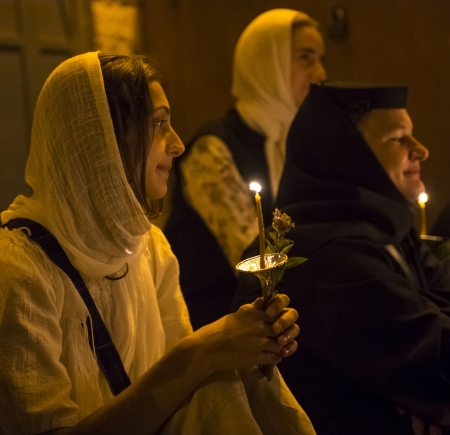 nuns: JERUSALEM - AUGUST 25 : Unidentified nuns take part in a candle procession as part of the feast of the Assumption of the Virgin Mary on August 25 2012 in old Jerusalem Israel