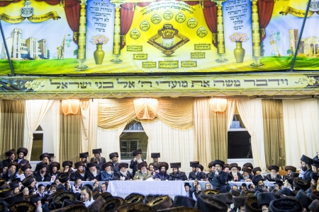 BNEI BRAK , ISRAEL - OCT 01 : Orthodox Jews from the Hasidic dynasty Vizhnitz celebrates Simchat beit Hashoeivah in Bnei Brak Israeel on October 01 2012 , It's a special celebration held by Jews during Sukkot Stock Photo - 16768312