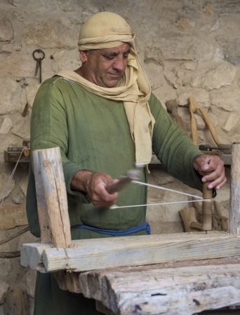 NAZARETH, ISRAEL - OCT 15 : Palestinian carpenter work with traditional tools in October 15 2012 at Nazareth Village, historical re-creation of Nazareth as it was at the time of Christ Stock Photo - 16768274