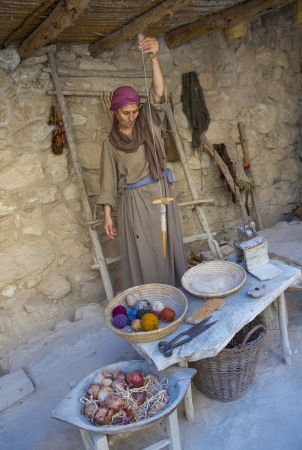 crist: NAZARETH, ISRAEL - OCT 15 : Palestinian traditional weaver in October 15 2012 at Nazareth Village, historical re-creation of Nazareth as it was at the time of Christ