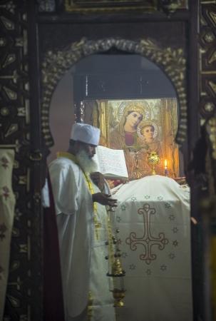 ethiopian: JERUSALEM - AUGUST 08 : Ethiopian priest prays at the Ethiopian Church in Jerusalem , Israel on August 08 2012 , Ethiopian church is The only pre-colonial Christian church of Sub-Saharan Africa