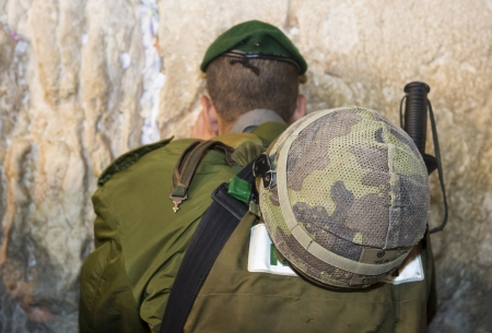 JERUSALEM - SEP 25 :Israeli soldier prays during the penitential prayers the Selichot , held on September 25 2012 in the Wailing wall in Jerusalem Israel  Editorial