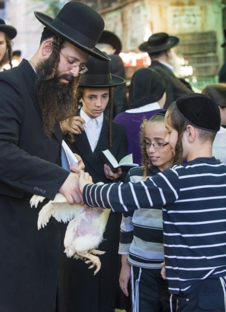 JERUSALEM - SEP 25 : An ultra Orthodox Jewish children holds a chicken during the Kaparot ceremony held in Jerusalem Israel in September 25 2012  Editorial