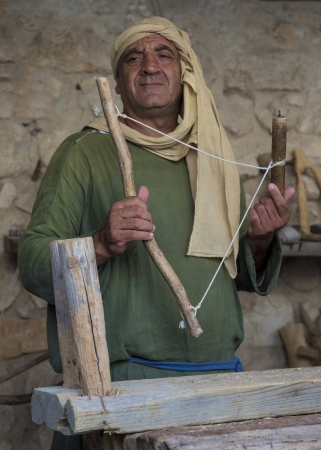 NAZARETH, ISRAEL - OCT 15 : Palestinian carpenter work with traditional tools in October 15 2012 at Nazareth Village, historical re-creation of Nazareth as it was at the time of Christ Stock Photo - 17003726