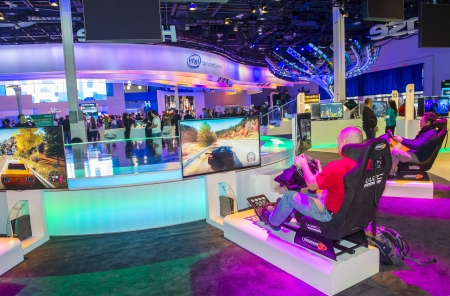 LAS VEGAS - JANUARY 11 : people playing video games at the CES show held in Las Vegas on January 11 2013 , CES is the world's leading consumer-electronics show and companies from all over the world come to show their latest technologies and products.