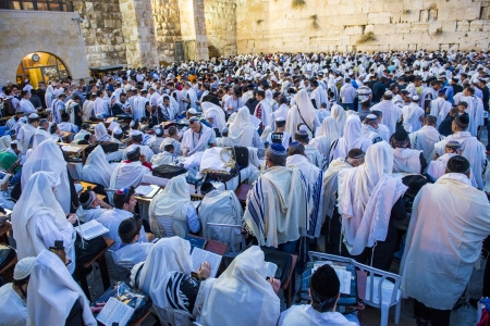 selichot: JERUSALEM - SEP 25 : Jewish men prays during the penitential prayers the Selichot , held on September 25 2012 in the Wailing wall in Jerusalem Israel  Editorial