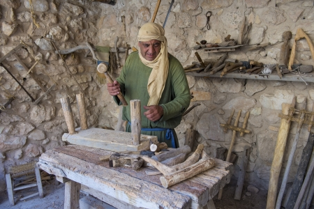 NAZARETH, ISRAEL - OCT 15 : Palestinian carpenter work with traditional tools in October 15 2012 at Nazareth Village, historical re-creation of Nazareth as it was at the time of Christ