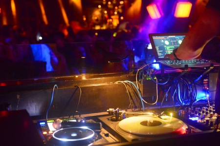 A dj mixer in a night club