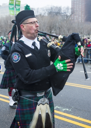 CHICAGO - MARCH 16 : Bagpiper at the annual Saint Patrick's Day Parade in Chicago on March 16 2013