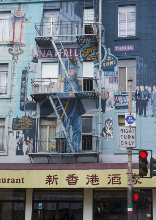 SAN FRANCISCO - MARCH 20 : Apartment building with decorative graffiti in San Franciscos Chinatown on March 20 2013 , San Franciscos Chinatown the oldest Chinatown in the US