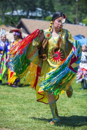 pow wow: MARIPOSA ,USA - MAY 11 : Unidentified Native Indian dancer takes part at the Mariposa 20th annual Pow Wow in California , USA on May 11 2013 ,Pow wow is native American cultural gathernig event.