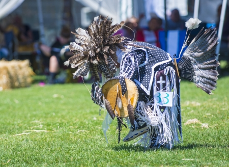 pow wow: MARIPOSA ,USA - MAY 11 : An unidentified Native Indian boy takes part at the Mariposa 20th annual Pow Wow in California , USA on May 11 2013 ,Pow wow is native American cultural gathernig event. Editorial